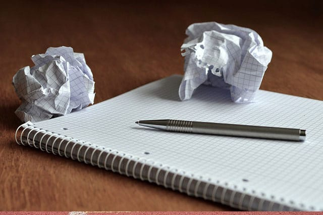 crumbled up paper and notepad
